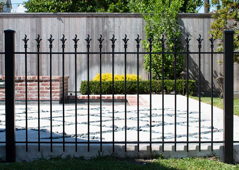 iron fence and concrete patio