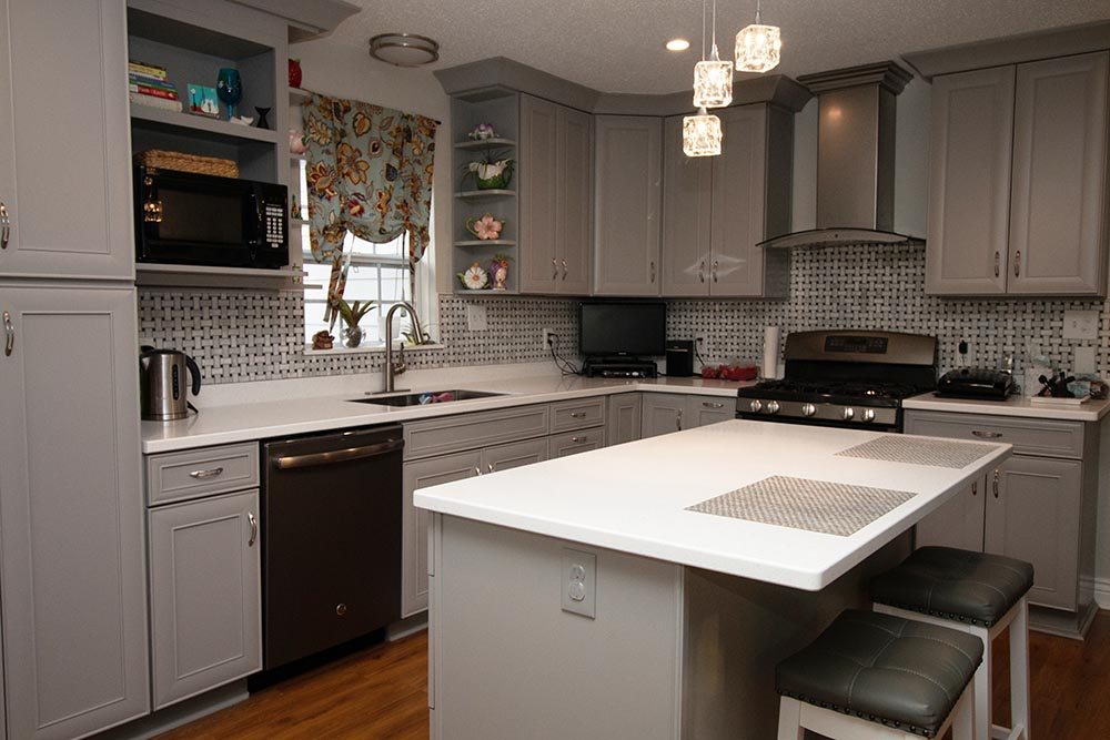 gray and white kitchen with stainless appliances