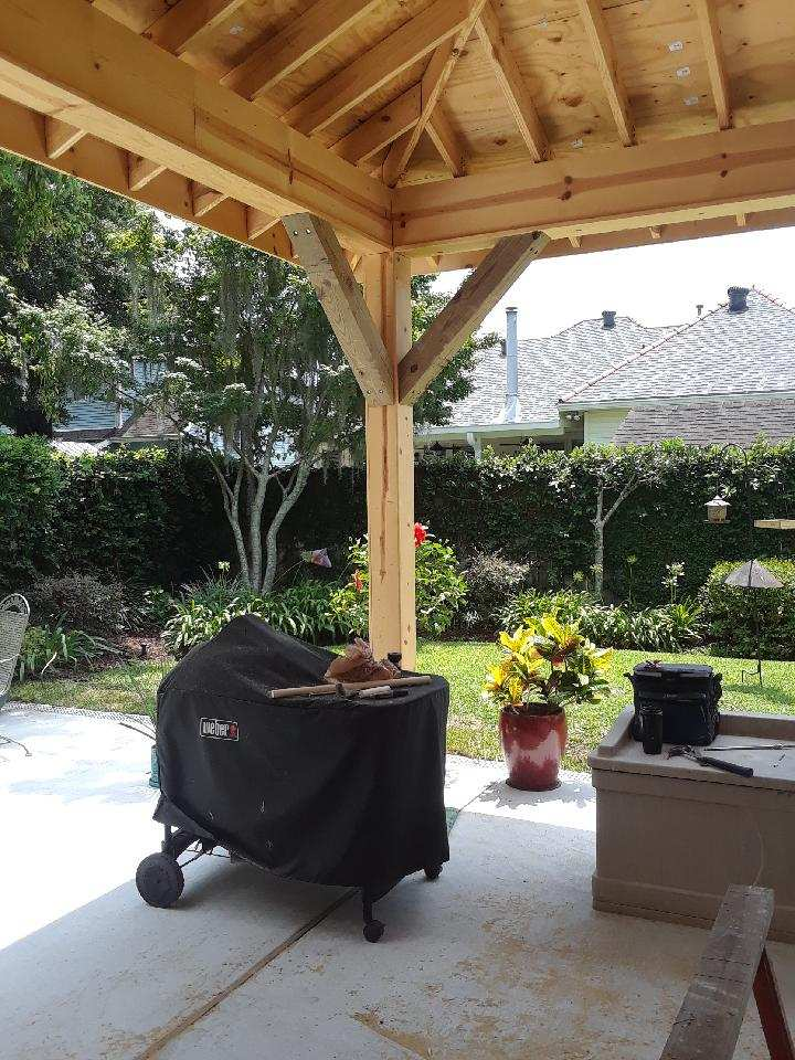 wooden gazebo in backyard