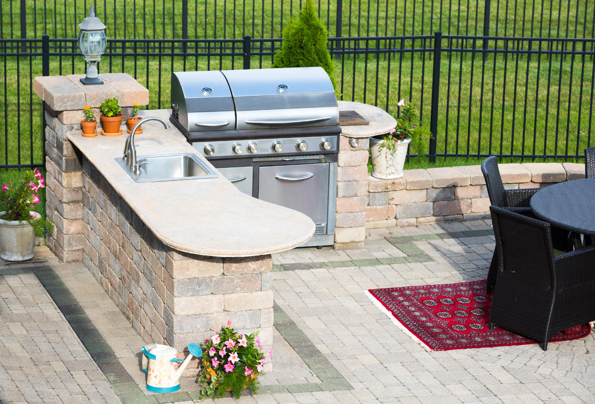 Outdoor kitchen on a brick patio