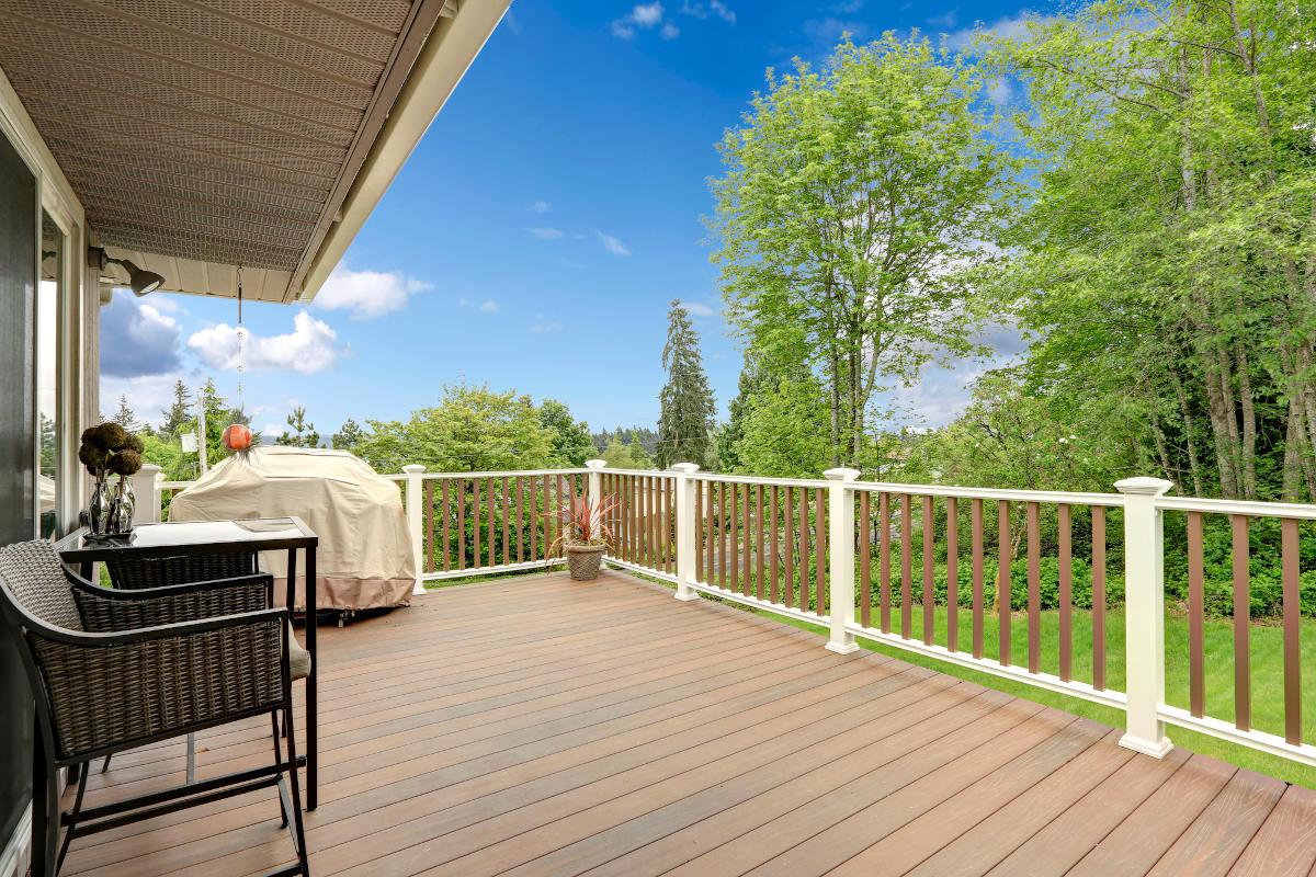 wooden deck overlooking lawn
