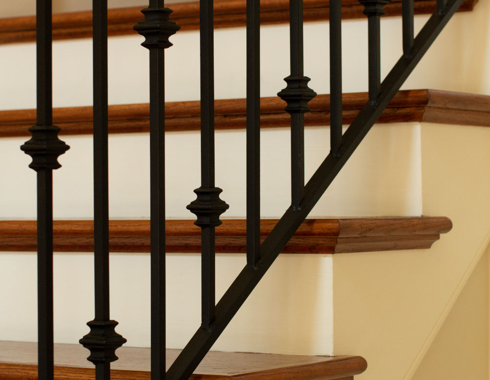 intricate staircase metal railing