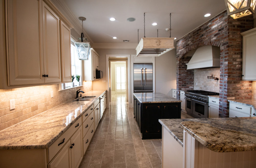 spacious kitchen with brick, ceramic, and granite
